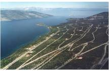 Close to Athens 30 Ha waterfront land approved for the development of a resort, yacht marina and villas for sale in MAINLAND GREECE, 90 km. FROM ATHENS AIRPORT